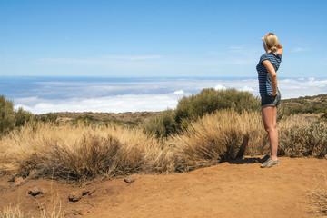 Woman looking ahead at the horizon