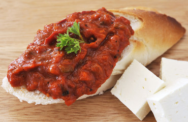 Bulgarian Chutney on bread and feta cheese.