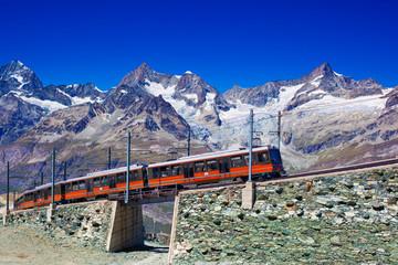 Fototapete - Train in Alps