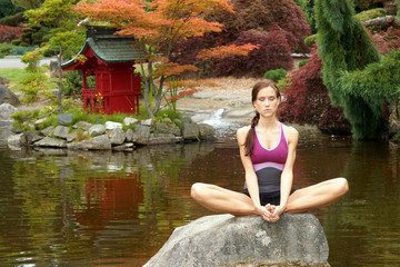 Healthy woman practices Yoga in beautiful Yoga Pond
