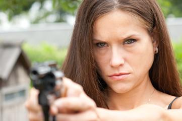 Handgun Range Shooting Practice by Angry Looking Female