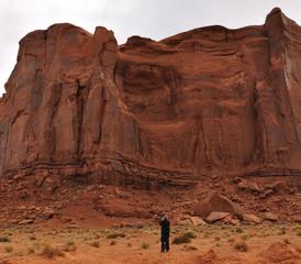 Man Taking a Photograph of the Rain God Mesa