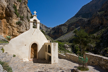 Little white chapel in mountains of Crete