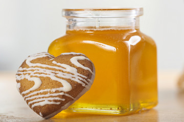 Heart-shaped cookies and a jar of honey
