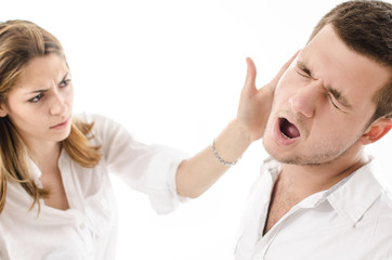 angry young woman slap boyfriend with her hand