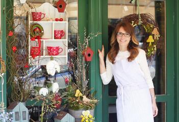 Smiling Mature Woman Florist  At Flower Shop