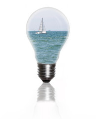 light bulb with sea and sailboat