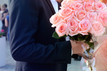 Man holding bouquet in hands to be given as a gift