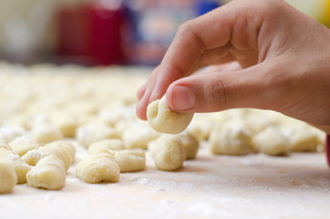 Hand preparing homemade italian gnocchi