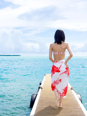 beautiful asian woman relaxing on the jetty