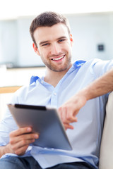 Man relaxing with digital tablet