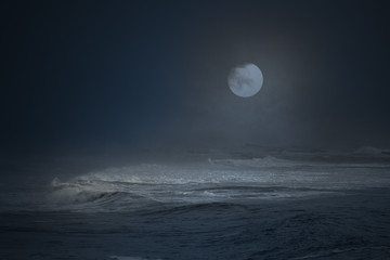 Foggy moon over the sea