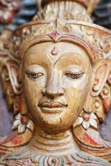 Buddha head on church door