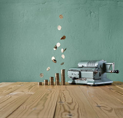 vintage calculator and money rain