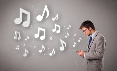 attractive young man singing and listening to music with musical