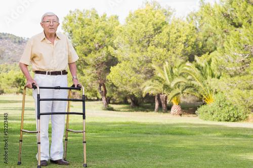 Portrait of old man using zimmer frame\