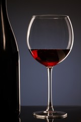 Elegant photo of a glass of red wine