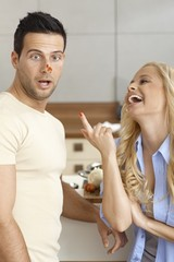 Young couple having fun in kitchen