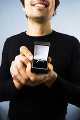 Happy man proposing to you