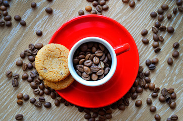 cup with coffee beans on a dark background