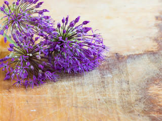 Fresh flowers of allium on wooden table