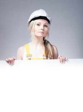 Young builder woman construction worker, empty frame