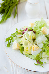 diet salad with boiled egg and lettuce