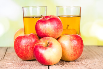 Wall Mural - Two glasses of apple juice