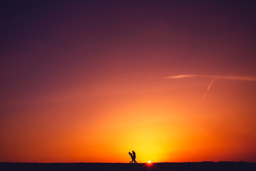 Silhouette of a loving couple at sunset