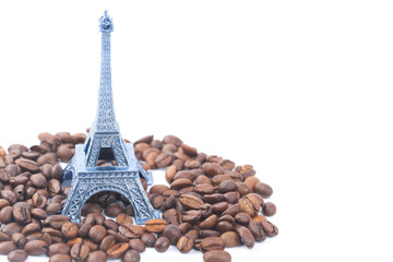 Eiffel Tower and coffee beans isolated on a white backgrounds