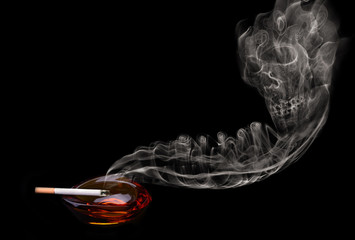 Ashtray and cigarette with smoke skull shape isolated on black