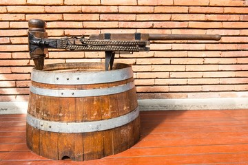 Vintage rusty steel and wooden wine bottle processing equipment