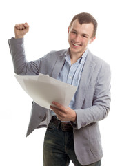 Happy young the man with papers
