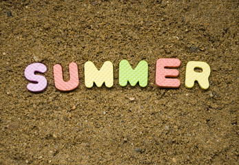 summer symbol and sand background