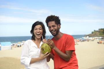 Multiracial couple coconut water Rio de Janeiro, Brasil