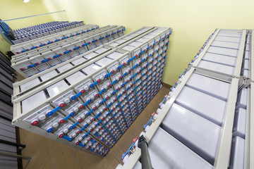 Rows of batteries in industrial backup power system.