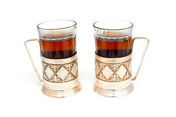 glass of black tea with glass holder isolated on white backgroun
