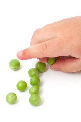 fresh peas and child's hand