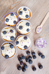 Delicious cupcake with blueberries, cream and fresh berries