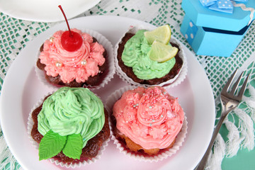 Delicious beautiful  cupcakes on dining table close-up