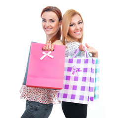 Happy friends two girls with shopping bags