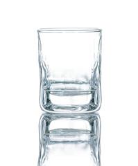 Empty vodka or whisky glass beaker isolated on white background