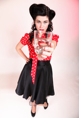 Young woman retro style drinking water