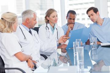 Medical team examining a file