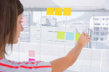 Woman pasting sticky note