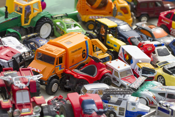 tons of plastic toys and cars