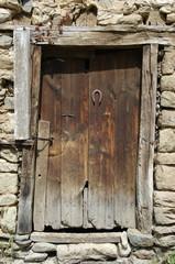 Rusty Horseshoe On Rustic Door