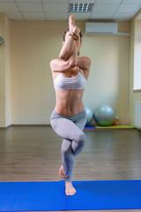 Young woman standing in yoga asana