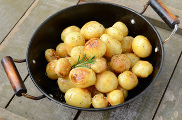 Whole fried young potato with rosemary