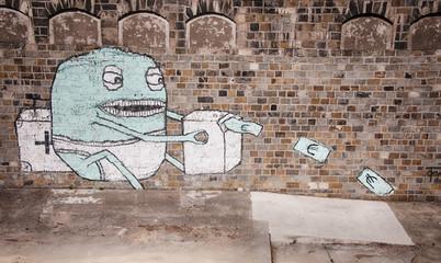 Graffiti in Vienna showing baby monster printing money